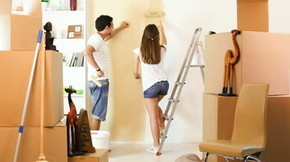 stock-footage-young-couple-decorate-their-new-apartment-moving-i_phixr